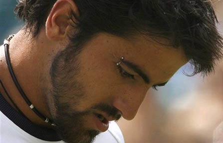 The heavily-accessorized Janko Tipsarevic — with his piercings, tattoos,